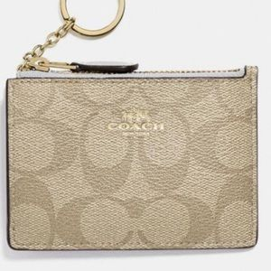 Coach khaki and white ID wallet